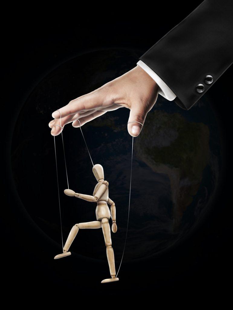 Bild einer Hand mit einer Marionette